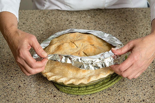 When there are 20 minutes left in the baking process, carefully remove the foil and place the pie back in the oven for the remainder of the cooking time.
