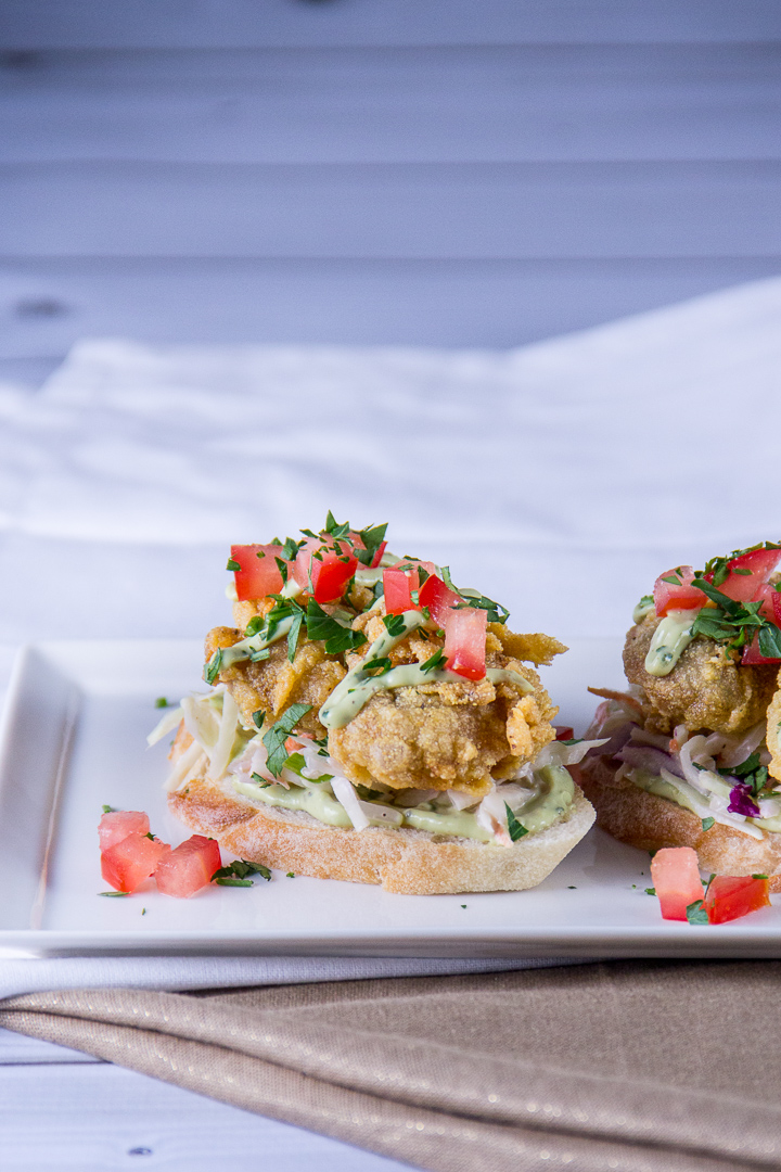 Fried Oysters with Slaw and Lime Cilantro Avocado Sauce